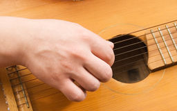 Guitar strings actor hands Stock Photos