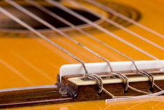 Guitar strings. Classical Guitar Bridge closeup, Show Strings Installation Stock Photo