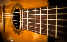 Guitar strings. Classical wooden guitar strings close up Royalty Free Stock Images