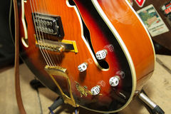 Guitar strings closeup. With rockabilly upgrade of dice Royalty Free Stock Photography