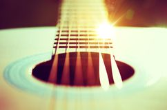 Guitar Strings Concept. Photo. Guitar Playing Theme with Sun Rays Reflections royalty free stock photography