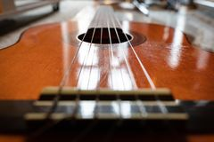 Guitar strings. The guitar strings define a path in the space stock images