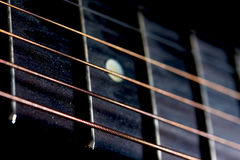 Guitar strings and frets. With DOF royalty free stock image