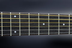 Guitar strings and frets. Close acoustic guitar strings and frets Stock Images