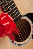 Guitar Strings with Red Ribbon. The Gift of Music stock photography