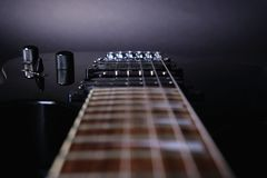 Guitar stringsand fretboard, close up. Electric guitar. .Soft selective focus. On black. Background royalty free stock images