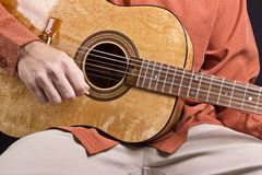 Guitar strumming Stock Photos