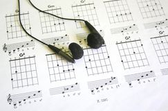 Guitar tab. With black headphones royalty free stock image