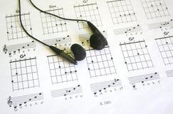 Guitar tab. With black headphones Royalty Free Stock Image