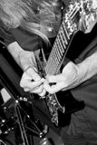 Guitar Tapping. Black-and-white photo of a heavy metal guitarist tapping a solo on his Ibanez guitar. Serie of 3 photos stock photos