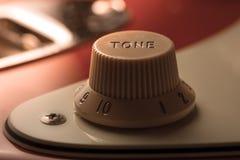 Guitar tone knob detail Royalty Free Stock Photography