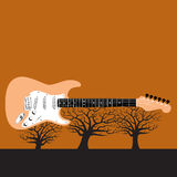 Guitar on trees. An illustrated guitar resting on leafless tress against and red orange sky background.  Available in vector format Royalty Free Stock Photos