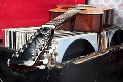 Guitar on a trunk full of old vinyl records Royalty Free Stock Photography