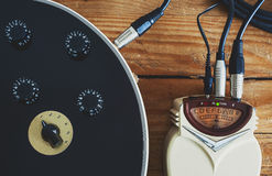 Guitar Tuner. Details of an old guitar tuner, solid built with dust on surface, turned on Royalty Free Stock Photos