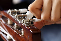 Guitar tuning. Tuning a guitar Royalty Free Stock Photo