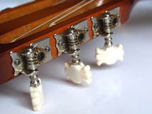 Guitar tuning keys. Detail of a folk acoustic guitar - tuning keys Royalty Free Stock Photo