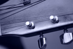Guitar tuning pegs and posts on guitar head, macro Royalty Free Stock Photo
