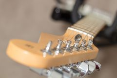Guitar tuning pegs. Tuning peg on a guitar headstock Royalty Free Stock Photos