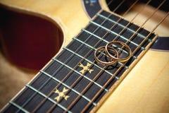 Guitar. Two wedding rings on guitar Royalty Free Stock Image