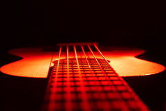 Guitar Ukulele on Red Light Stock Photo