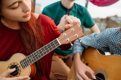Guitar ukulele string instrument music culture art. Guitar and ukulele string musical instruments. Music art style culture. Equipment tuning Royalty Free Stock Photo