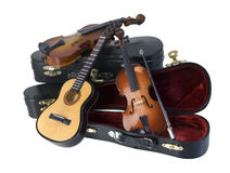 Guitar and Violins with Cases Royalty Free Stock Image