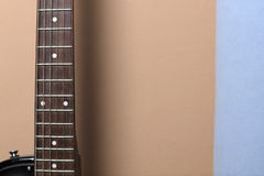 Guitar on the wall Stock Photo