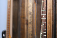 Guitar on the wall Royalty Free Stock Images