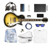 Guitar and wear and accessories on white background Royalty Free Stock Images