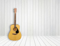 Guitar in white wood room. Guitar in blank empty white wood room background Royalty Free Stock Photo