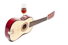 Guitar and wine Stock Photography