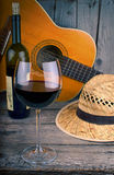 Guitar and Wine on a wood table Stock Photo