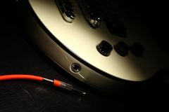 Guitar and wire Royalty Free Stock Photos