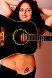 Guitar on a Woman Royalty Free Stock Photos