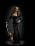 Guitar woman player fashion Royalty Free Stock Image