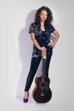 Guitar woman player fashion Royalty Free Stock Photos