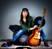 Guitar woman Stock Images