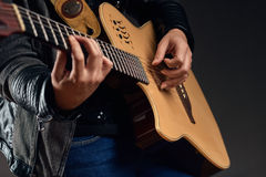 Guitar with woman`s hands Royalty Free Stock Images