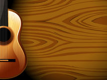 A guitar beside a wood-colored wall Royalty Free Stock Photo