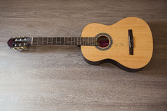 Guitar on wooden background Stock Photography