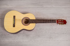 Guitar on wooden background Stock Images