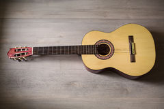 Guitar on wooden background Royalty Free Stock Images