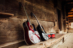 Guitar on a wooden porch Royalty Free Stock Photos