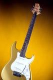 Guitare électrique d'or sur l'or Photo stock