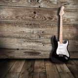 Guitare électrique dans la chambre Images libres de droits