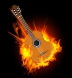 Guitare acoustique en flamme du feu Photo libre de droits
