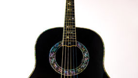 Guitare acoustique noire Photos stock