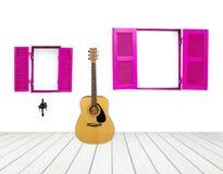Guitare avec la fenêtre sur le mur de ciment Photos stock