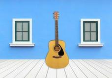 Guitare avec la fenêtre sur le mur de ciment Images libres de droits