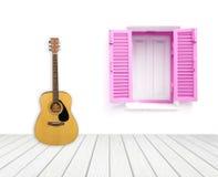Guitare avec la fenêtre sur le mur de ciment Photographie stock